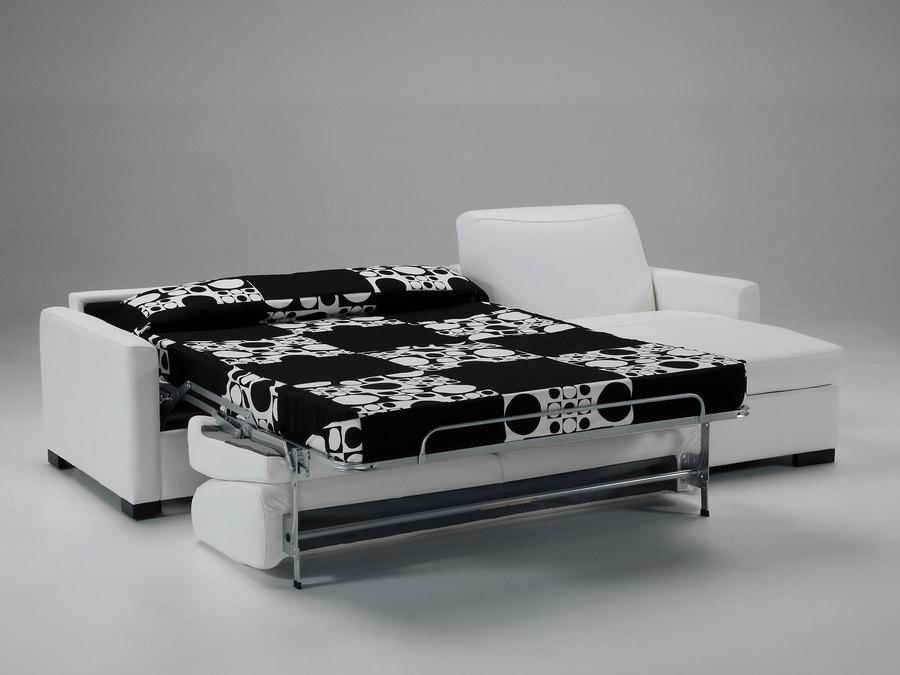 Composizione divano letto con penisola contenitore L 280 P 98/154/213 H92, materasso L 160 P 195 sp.14 cm (disponibile in altre misure) e rete elettrosaldata, completamente sfoderabile. Disponibile in altri tessuti ed ecopelle.